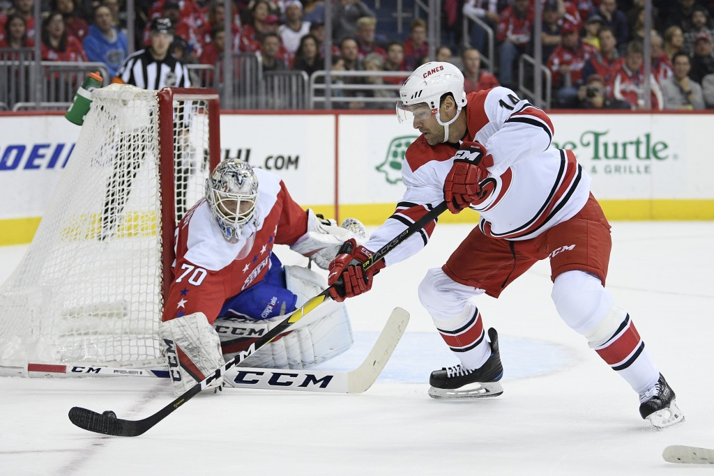 Carolina Hurricanes right wing Justin Williams (14) skates with the puck against Washington Capitals goaltender Braden Holtby (70) during the first pe...
