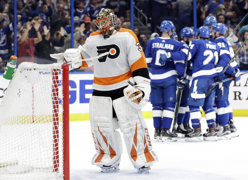 Philadelphia Flyers goaltender Michal Neuvirth (30) reacts as the Tampa Bay Lightning celebrate a goal by Tyler Johnson during the second period of an...
