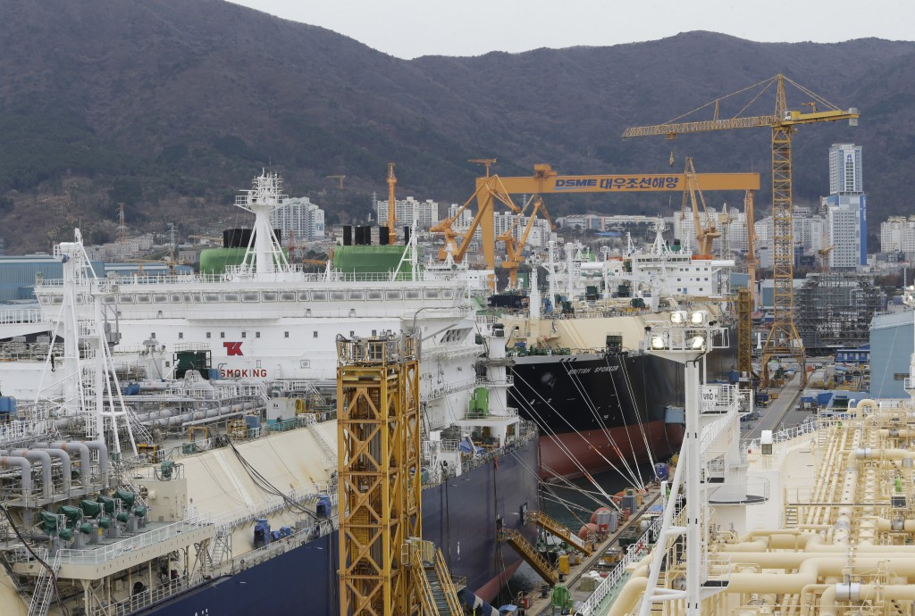 In this Friday, Dec. 7, 2018 photo, large-sized liquefied natural gas (LNG) carriers are being constructed at the Daewoo Shipbuilding and Marine Engin...