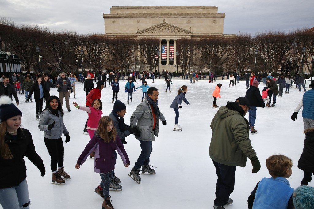 People skate on the National Gallery of Art Sculpture Garden Ice Rink, Thursday, Dec. 27, 2018, as a partial government shutdown continues in Washingt...