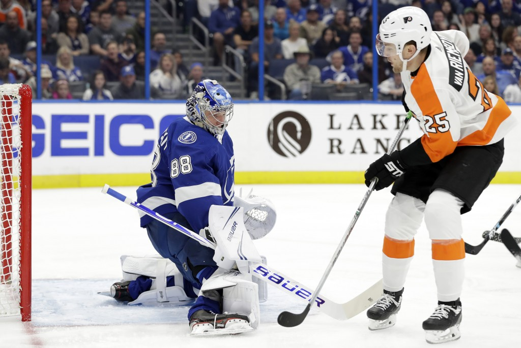 Tampa Bay Lightning goaltender Andrei Vasilevskiy (88) makes a save on a shot by Philadelphia Flyers left wing James van Riemsdyk (25) during the firs...