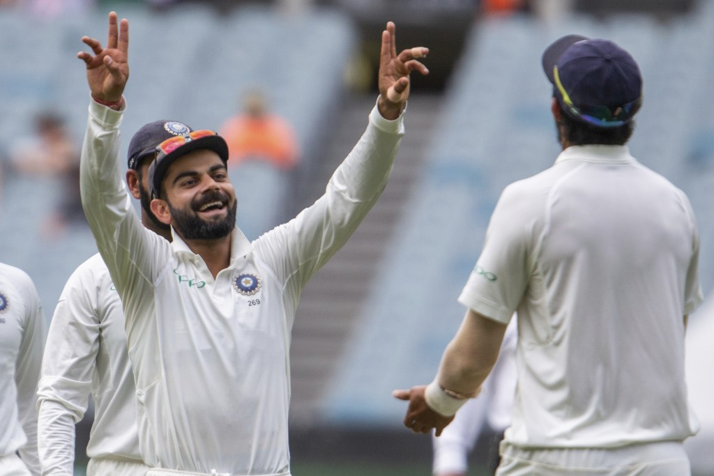 India's captain Virat Kohli, left, celebrates with Ishant Sharma after Sharma caught the wicket of Australia's Marcus Harris during play on day three ...