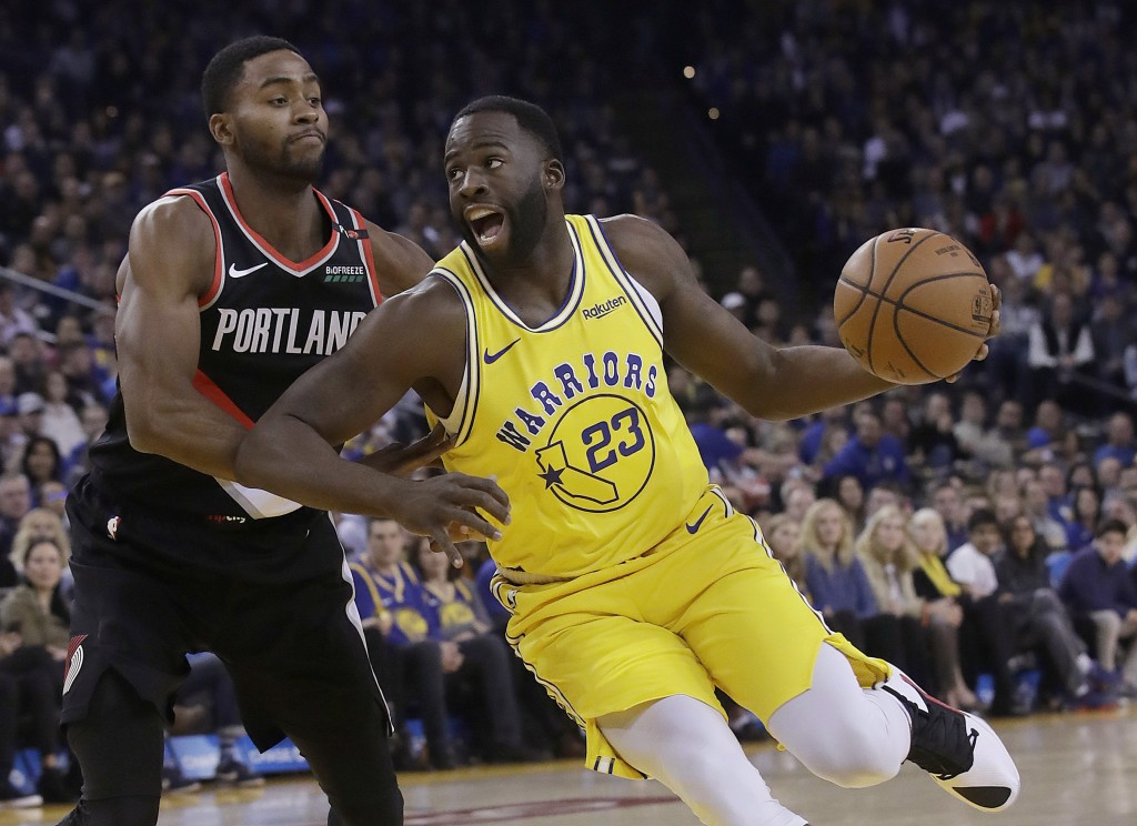Golden State Warriors forward Draymond Green (23) drives to the basket against Portland Trail Blazers forward Maurice Harkless during the first half o...