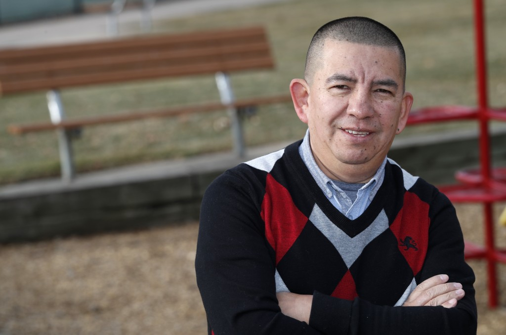 FILE - In this, Dec. 15, 2018, file photo, Pedro H. Gonzalez, bi-vocational Denver pastor and board member of Colorado Family Action, poses for a phot...