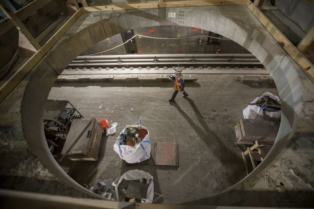 In this Nov. 29, 2018 photo, a construction worker walks on a train platform of the East Side Access project beneath Grand Central Terminal in New Yor...