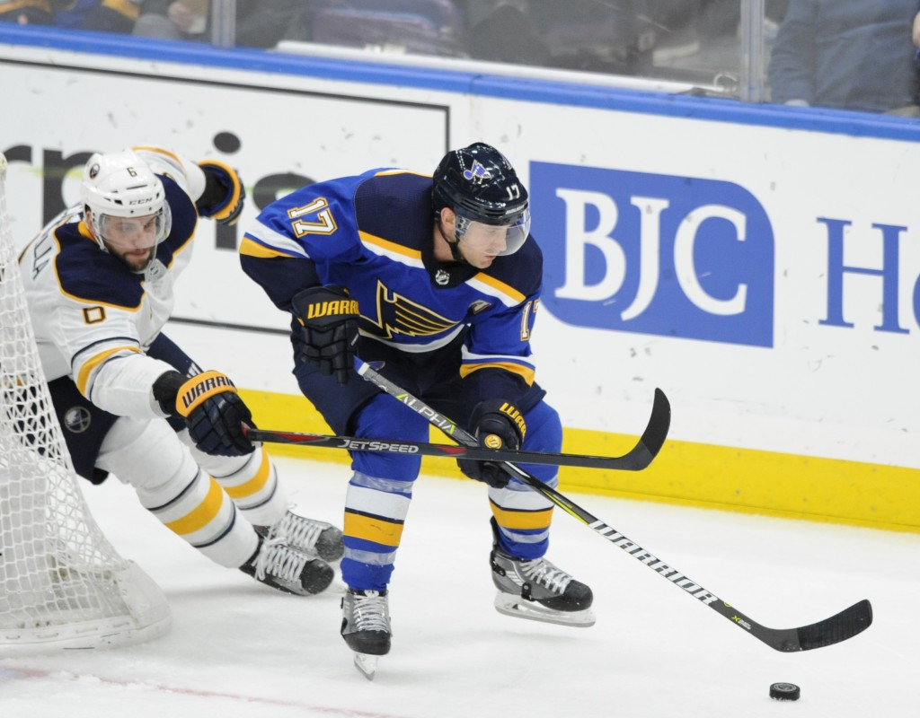 St. Louis Blues' Jaden Schwartz (17) gets the puck around Buffalo Sabres' Marco Scandella (6) during the second period of an NHL hockey game, Thursday