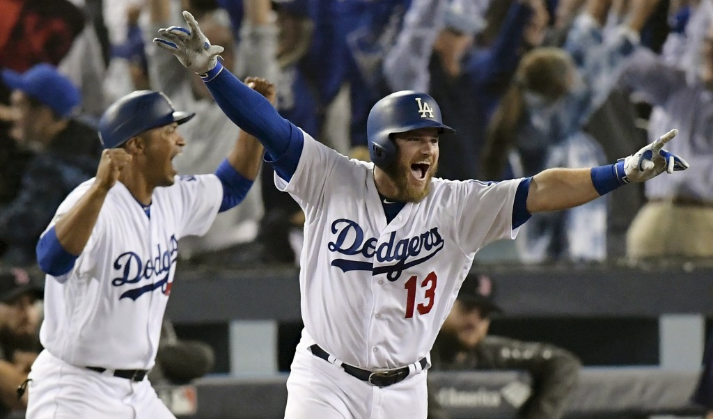 FILE - In this Oct. 27, 2018, file photo, Los Angeles Dodgers' Max Muncy, right, celebrates after hitting the game-winning home run in the 18th inning...