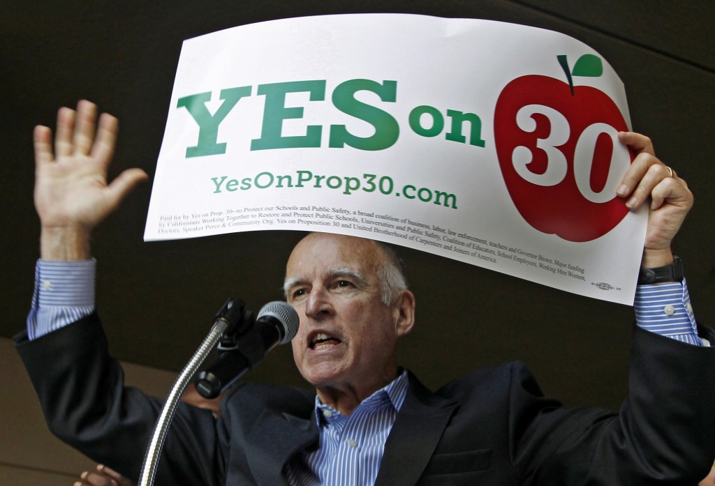 FILE - In this Nov. 3, 2012, file photo, Gov. Jerry Brown speaks at a rally in downtown Los Angeles for precinct walkers from the Service Employees In...