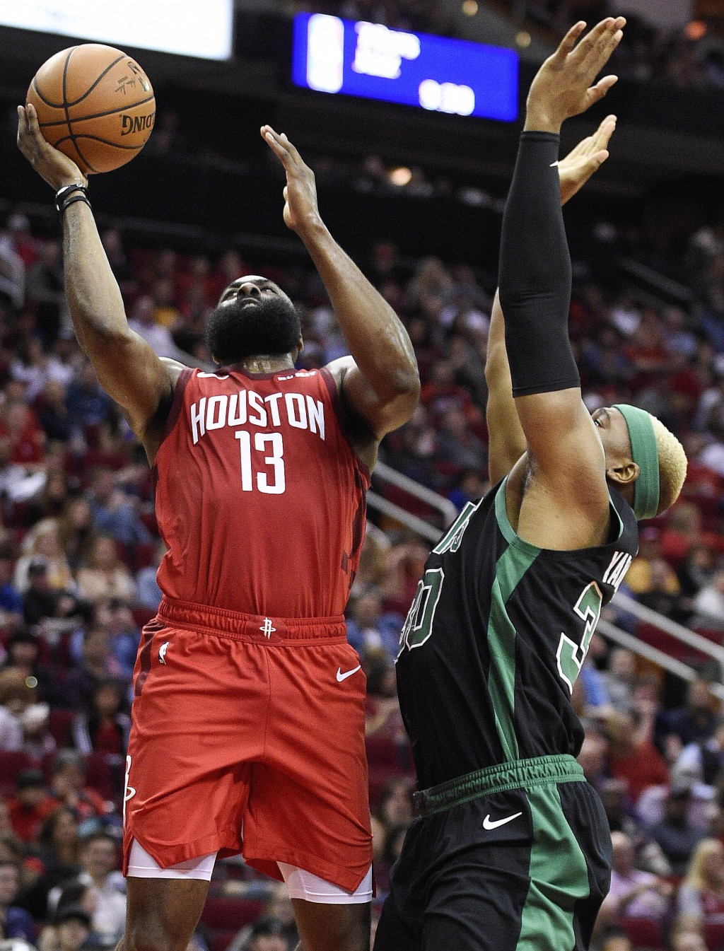 Houston Rockets guard James Harden (13) drives to the basket as Boston Celtics forward Guerschon Yabusele defends during the first half of an NBA bask...