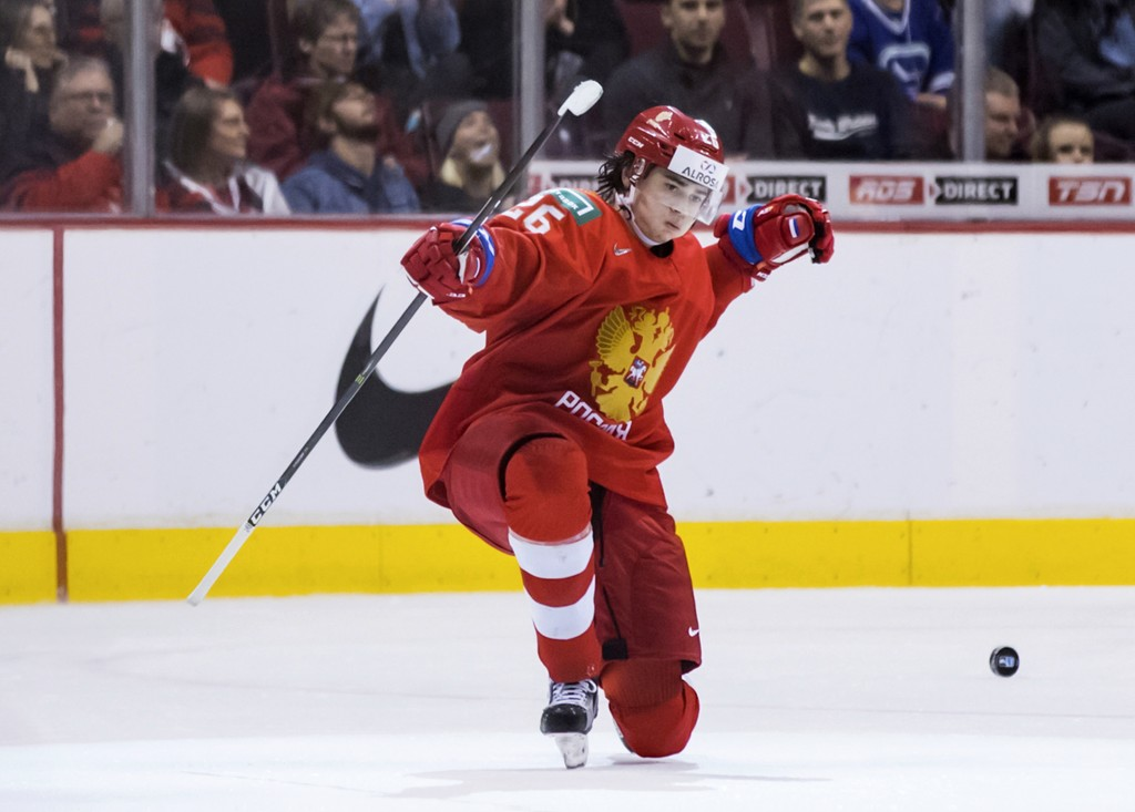 Russia's Alexander Romanov celebrates his goal against Denmark during second period IIHF world junior hockey championship action in Vancouver, British...
