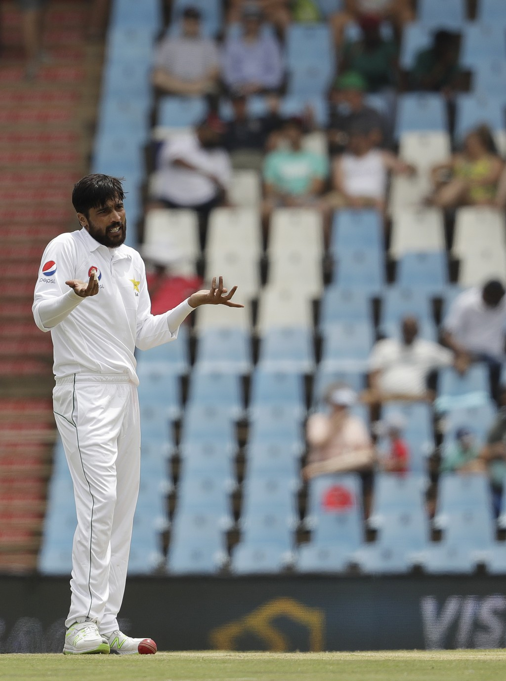 Pakistan's bowler Mohammad Amir gestures to the umpire after unsuccessful appealing for LBW on day three of the first cricket test match between South