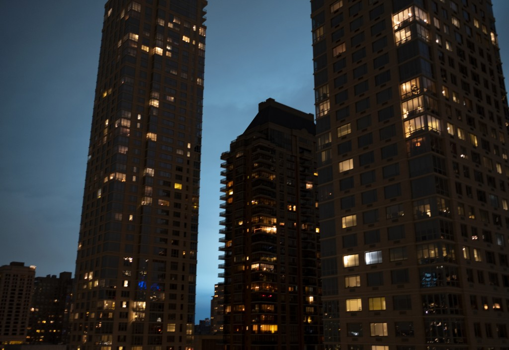 Viewed from the Upper West Side of Manhattan, the night sky is alight as a Con Edison facility in the Queens borough of New York experiences a transfo...