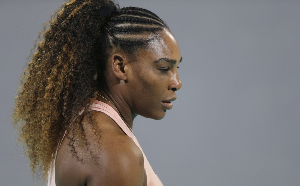 Serena Williams from the U.S. reacts during a match against her sister Venus, on the opening day of the Mubadala World Tennis Championship in Abu Dhab...