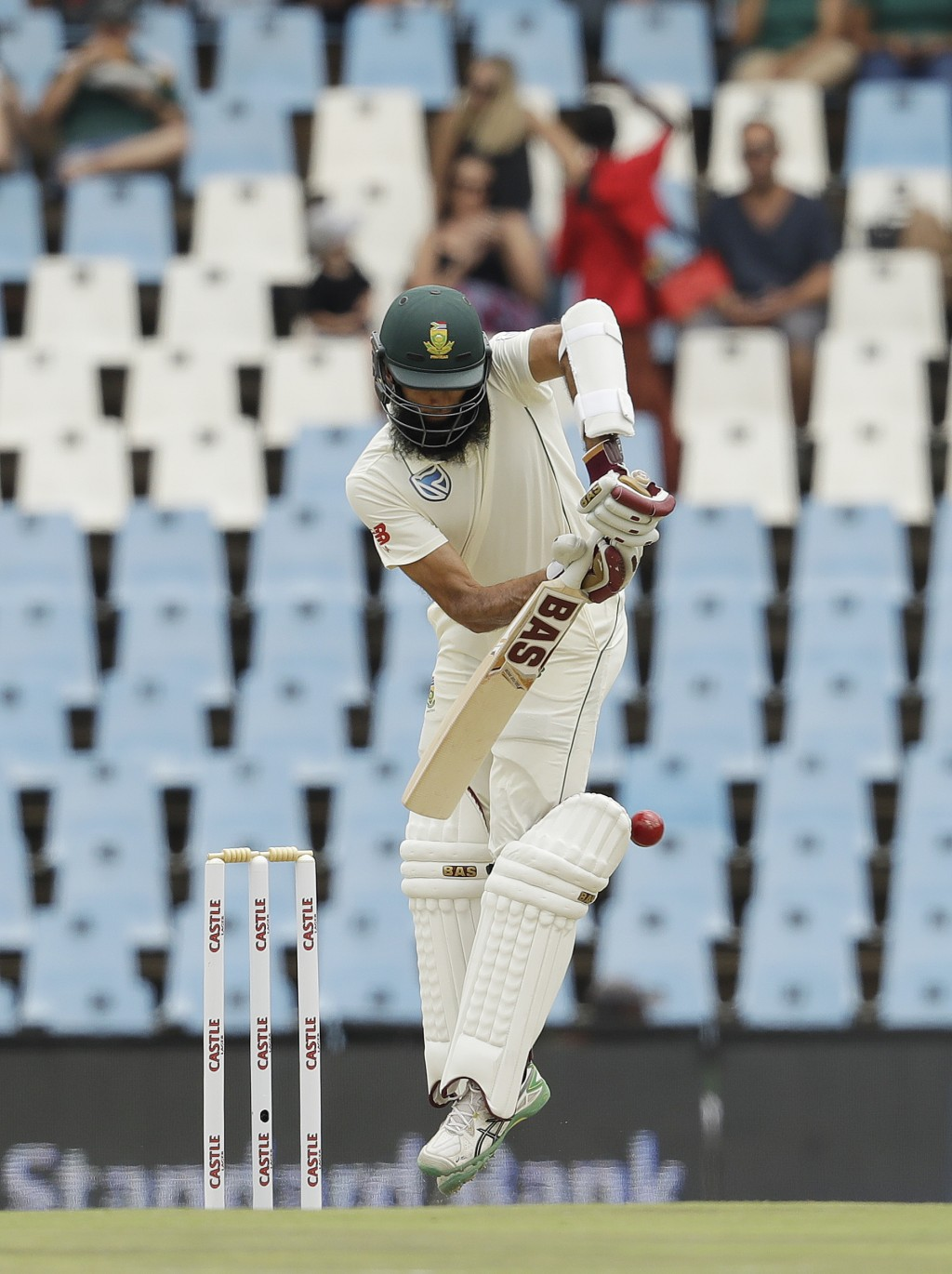 South Africa's batsman Hashim Amla bats on day three of the first cricket test match between South Africa and Pakistan at Centurion Park in Pretoria,