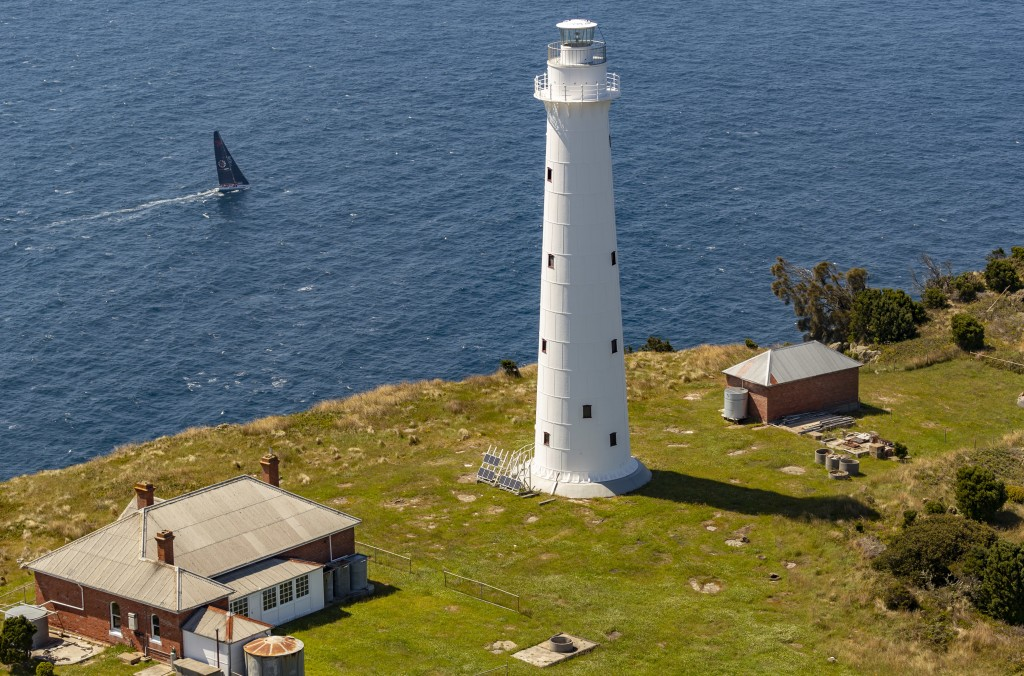 In this photo provided by Rolex/Studio Borlenghi, supermaxi Wild Oats XI sails past a lighthouse on the island state of Tasmania as they get close to ...