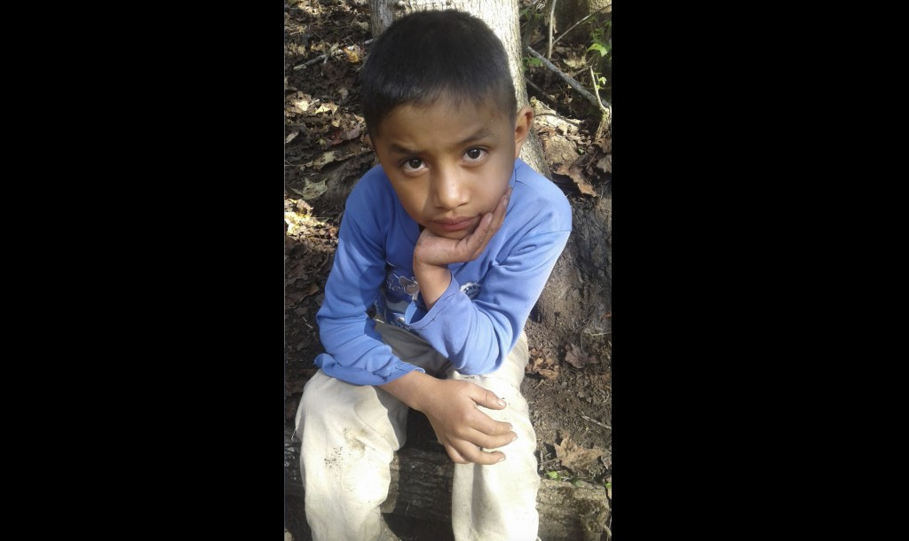 This Dec, 12, 2018 photo provided by Catarina Gomez on Thursday, Dec. 27, 2018, shows her half-brother Felipe Gomez Alonzo, 8, near her home in Yalamb...