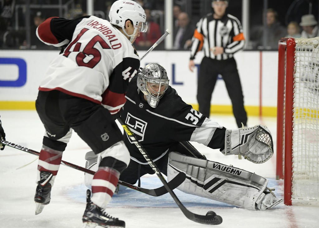 Arizona Coyotes right wing Josh Archibald, left, tries to score on Los Angeles Kings goaltender Jonathan Quick during the first period of an NHL hocke...