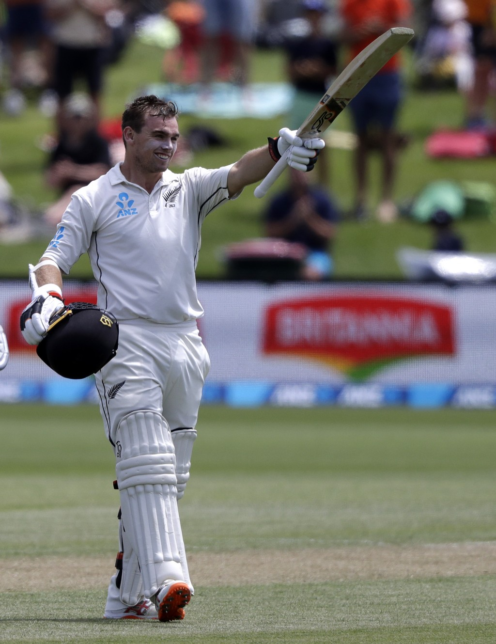 New Zealand's Tom Latham celebrates after scoring a century during play on day three of the second cricket test between New Zealand and Sri Lanka at H...