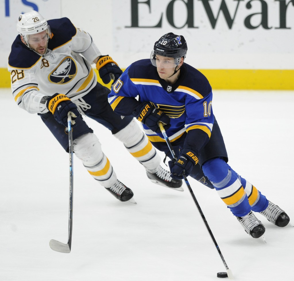 Buffalo Sabres' Zemgus Girgensons (28), of Latvia, chases St. Louis Blues' Brayden Schenn (10) during the third period of an NHL hockey game, Thursday