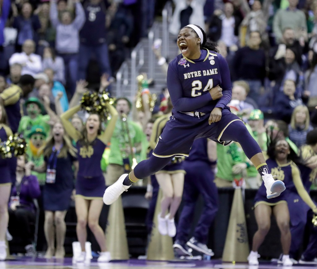 FILE - In this March 30, 2018, file photo, Notre Dame's Arike Ogunbowale celebrates after making the game-winning basket during overtime against Conne...