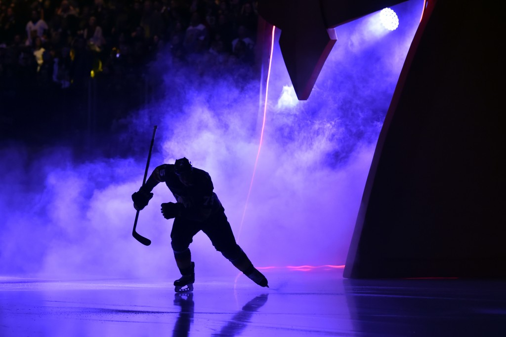 A Vegas Golden Knights player takes the ice before the team's NHL hockey game against the Colorado Avalanche on Thursday, Dec. 27, 2018, in Las Vegas....