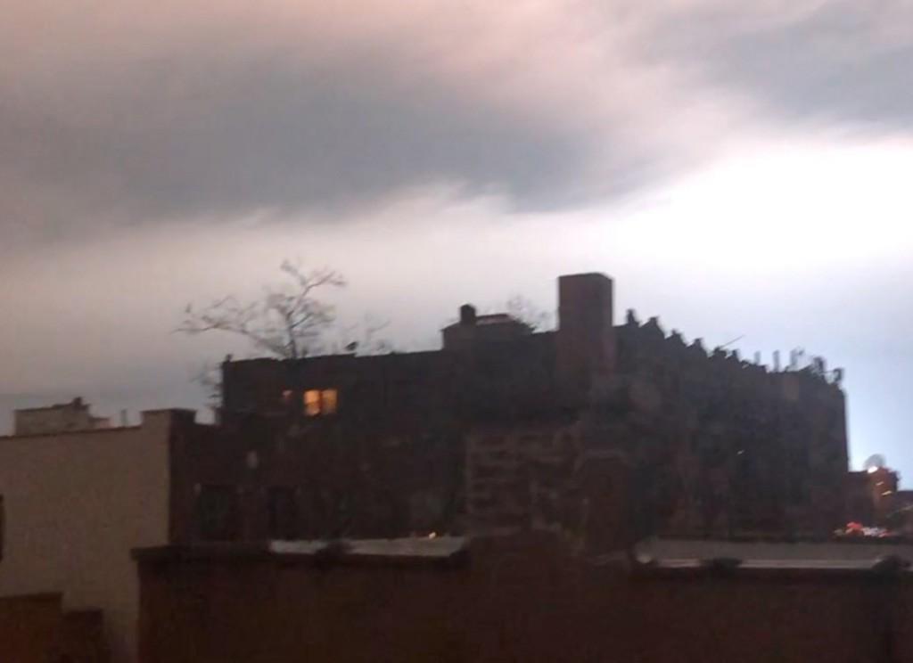 In this image taken from video, the night sky is illuminated after an explosion in the Queens borough of New York, Thursday, Dec. 27, 2018. New York p...