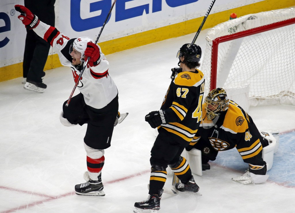 New Jersey Devils left wing Miles Wood (44) celebrates a Devils goal against Boston Bruins goaltender Jaroslav Halak as Bruins defenseman Torey Krug (...