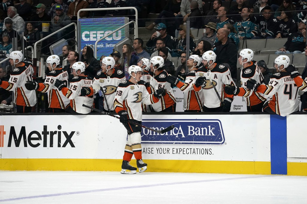 Anaheim Ducks right wing Jakob Silfverberg (33) is congratulated by teammates after scoring a goal against the San Jose Sharks during the first period...