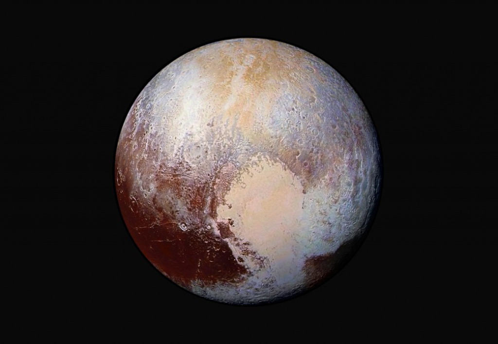 FILE - This image made available by NASA on Friday, July 24, 2015 shows a combination of images captured by the New Horizons spacecraft with enhanced