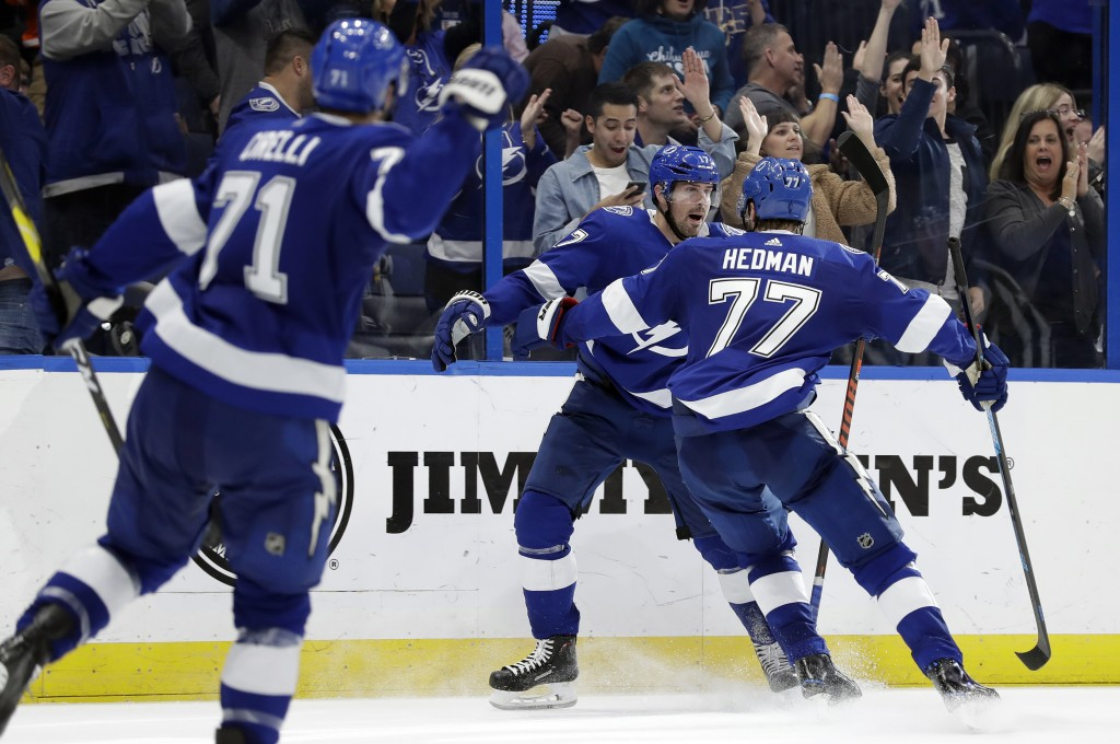Tampa Bay Lightning left wing Alex Killorn (17) celebrates his overtime goal against the Philadelphia Flyers with defenseman Victor Hedman (77) during...