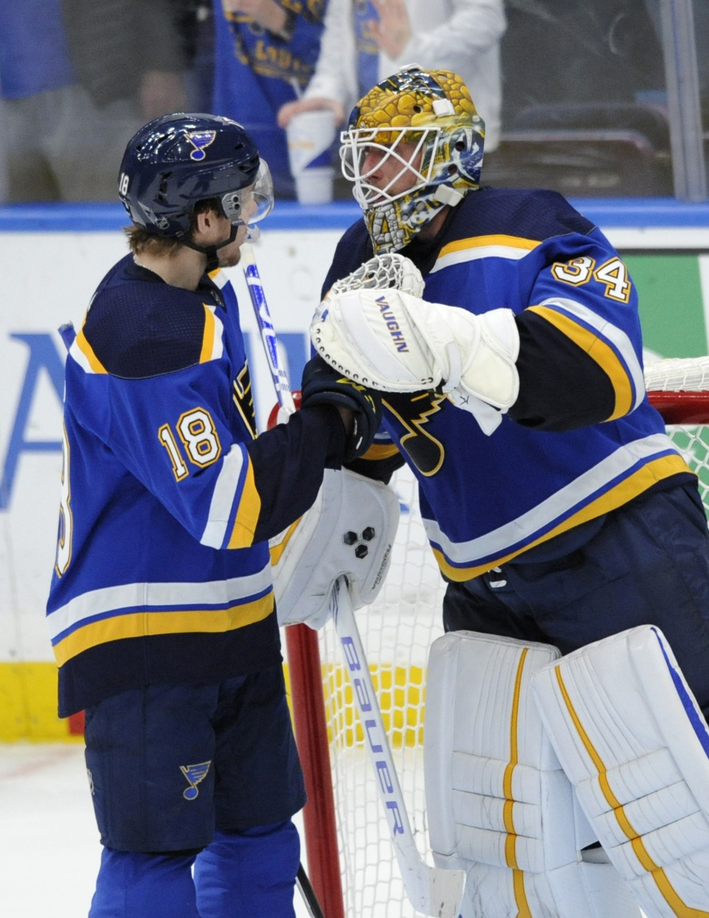 St. Louis Blues goalie Jake Allen (34) is congratulated by teammate Robert Thomas (18) after their victory over the Buffalo Sabres during in an NHL ho