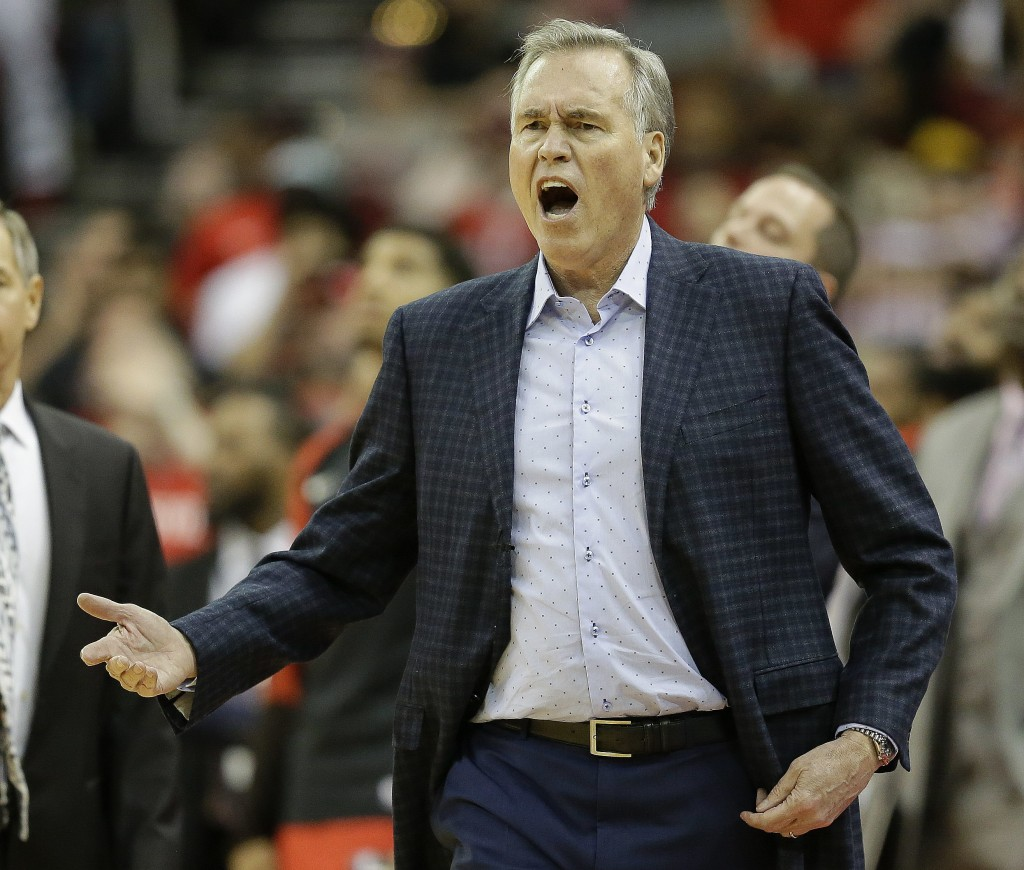 Houston Rockets head coach Mike D'Antoni reacts after being called for a technical foul during the first half of an NBA basketball game against the Bo...