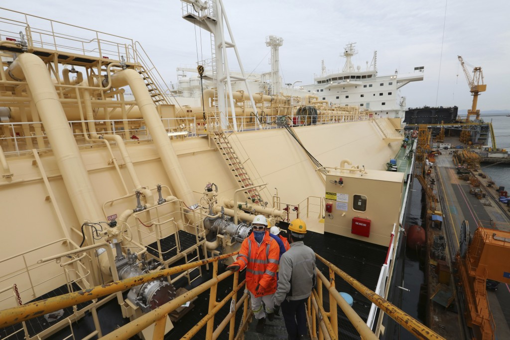 In this Friday, Dec. 7, 2018 photo, workers board large-sized liquefied natural gas (LNG) carriers under construction at the Daewoo Shipbuilding and M...
