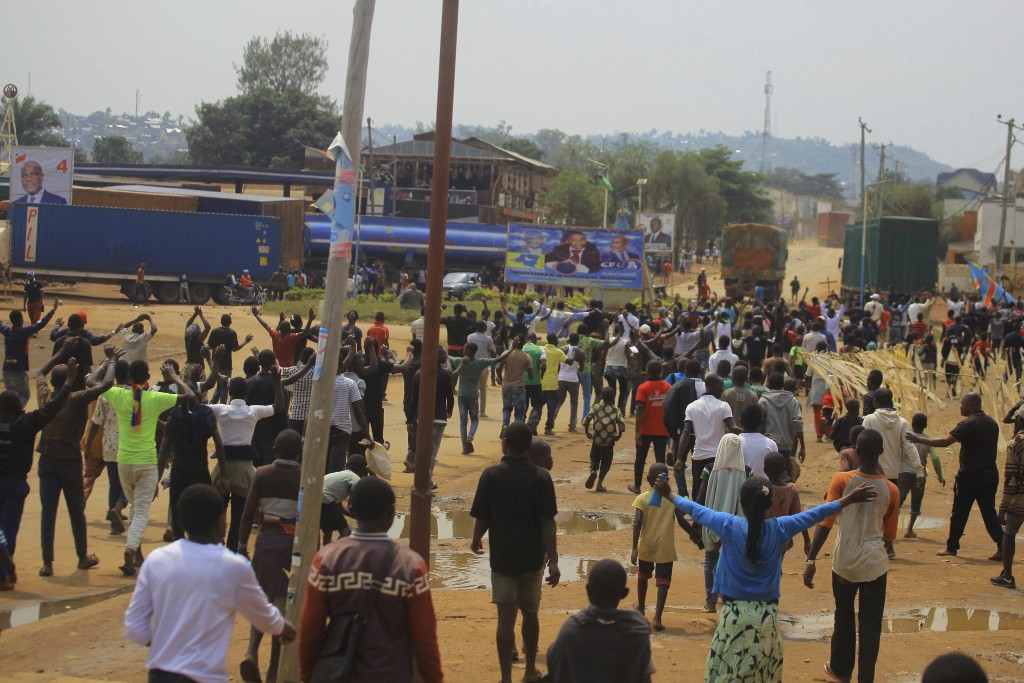 Protesters in the Eastern Congolese town of Beni, Friday Dec. 28, 2018, as they demonstrate against the election postponed until March 2019, announced...
