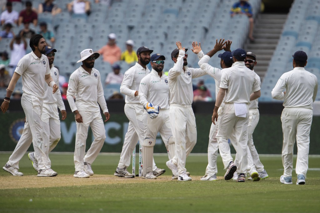 India's team celebrate the wicket of Australia's Aaron Finch during play on day three of the third cricket test between India and Australia in Melbour...