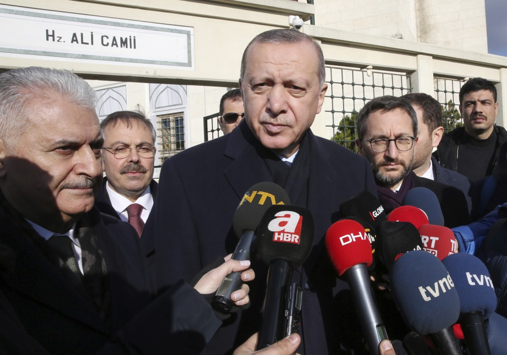 Turkey's President Recep Tayyip Erdogan speaks to journalists after Friday prayers, in Istanbul, Friday, Dec. 28, 2018. Erdogan says the facts on the ...