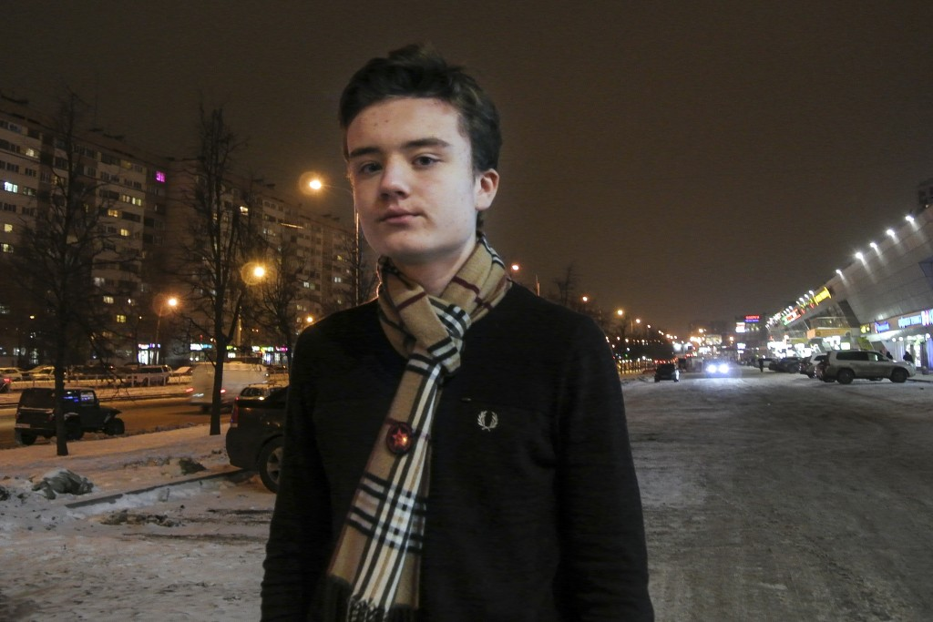 In this photo taken on Wednesday, Dec. 19, 2018, High school student Maxim Dautov poses for a picture in St. Petersburg, Russia. Two Russian high scho...