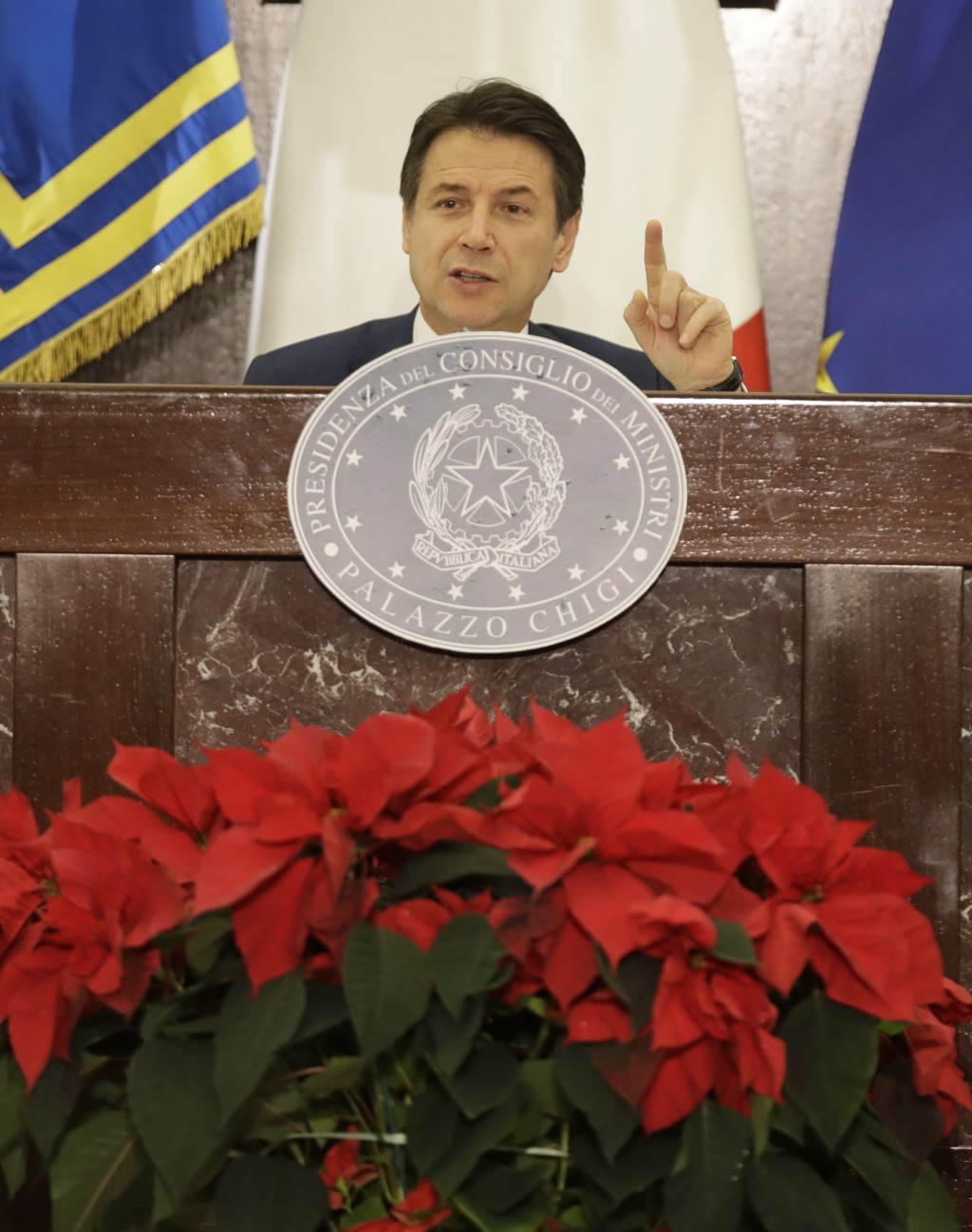 Italian premier Giuseppe Conte talks to reporters during a press conference in Rome, Italy, Friday, Dec.28, 2018. (AP Photo/Alessandra Tarantino)