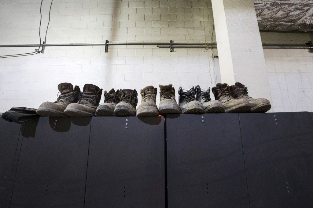 In this Nov. 29, 2018 photo construction boots are stored above lockers at the East Side Access project beneath Grand Central Terminal in New York. (A...