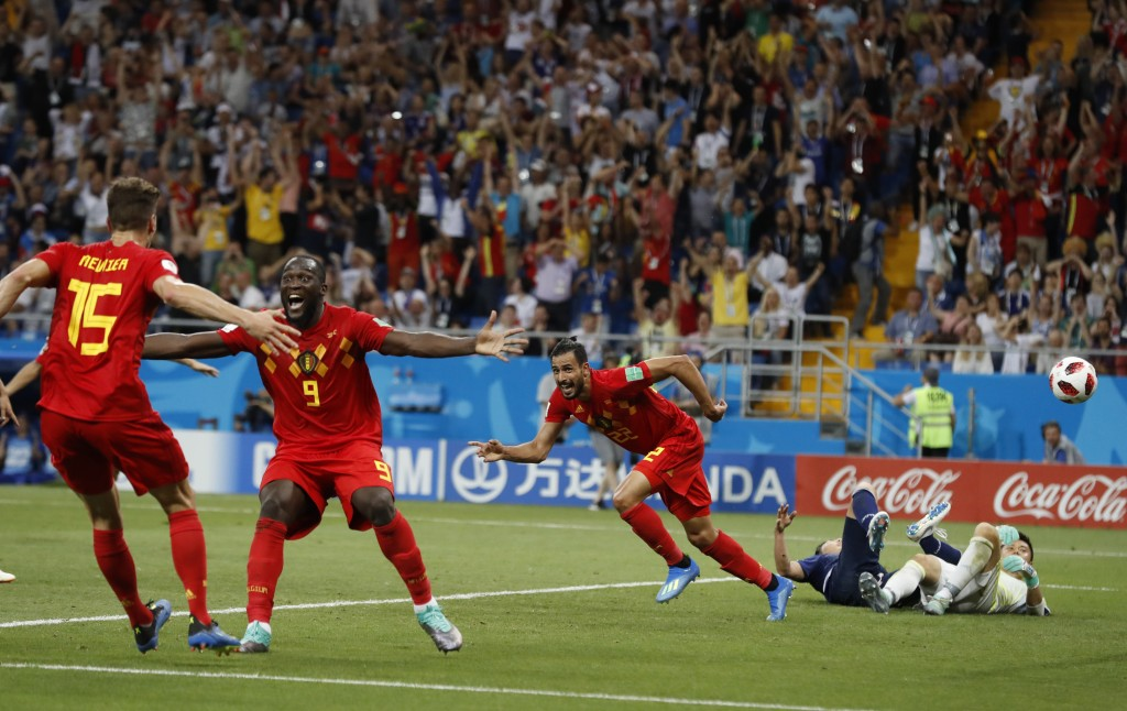 FILE - In this July 2, 2018, file photo, Belgium's Nacer Chadli, center, an his teammates, left, celebrate after Chadli scored his third side's goal d...