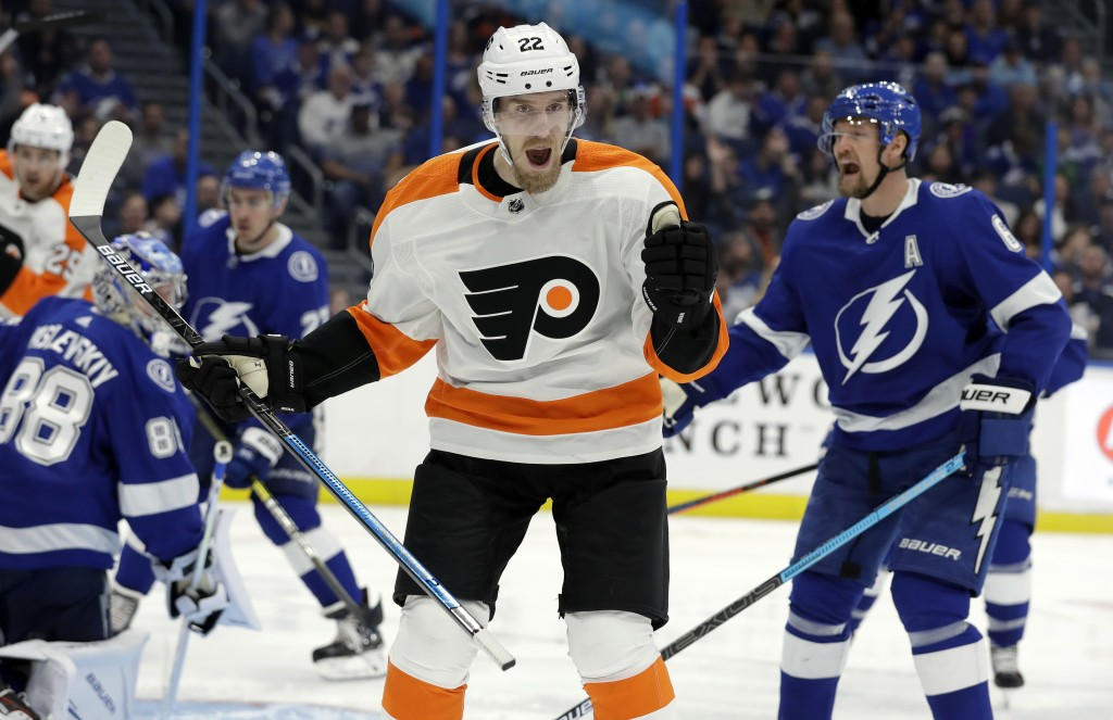 Philadelphia Flyers right wing Dale Weise (22) celebrates after scoring against the Tampa Bay Lightning during the third period of an NHL hockey game ...