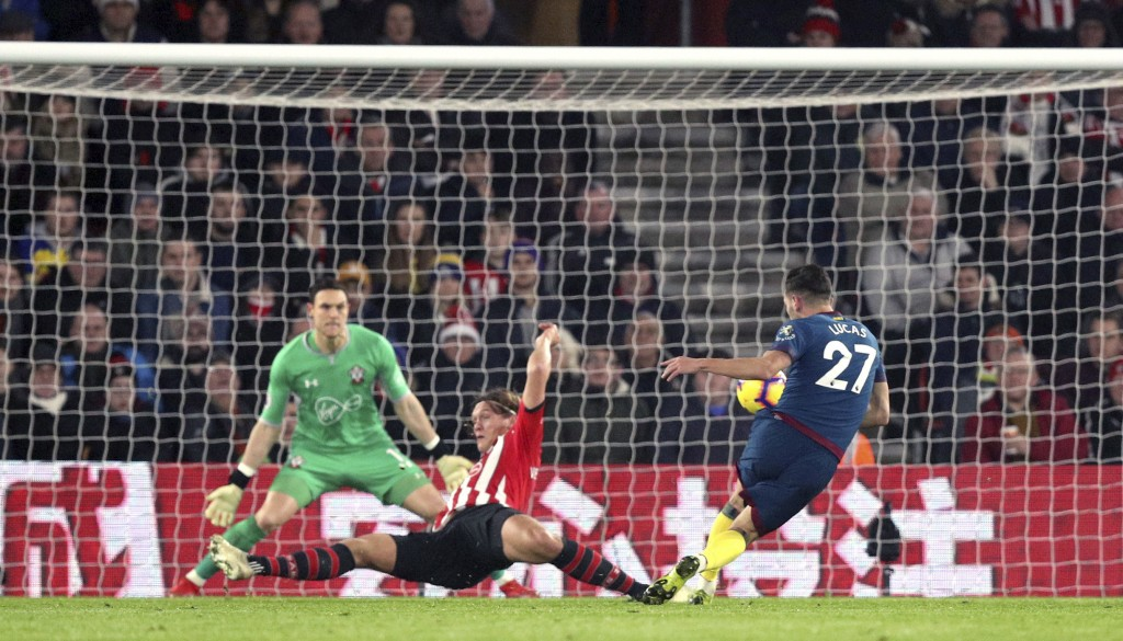 West Ham United's Lucas Perez, right, shoots wide during the English Premier League soccer match between Southampton and West Ham at St Mary's, in Sou...