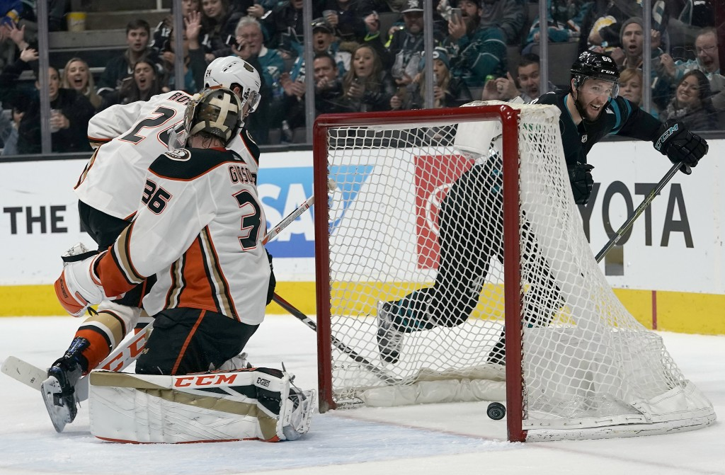 San Jose Sharks center Melker Karlsson, right, scores a goal past Anaheim Ducks goaltender John Gibson (36) during the first period of an NHL hockey g...
