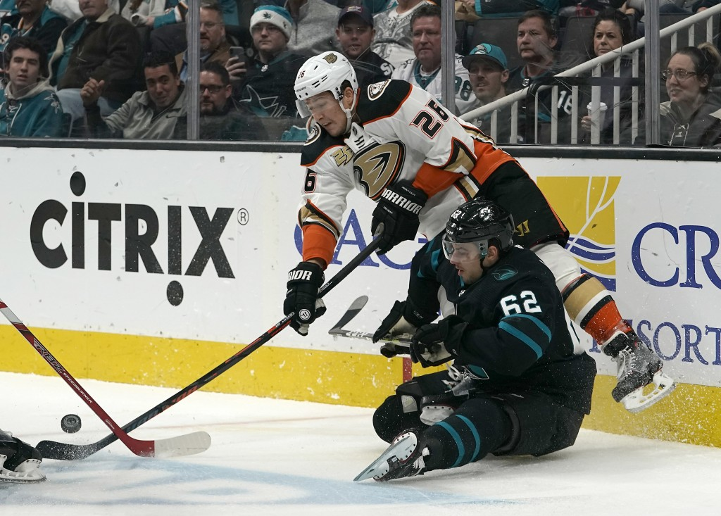 Anaheim Ducks defenseman Brandon Montour (26) battles for the puck against San Jose Sharks right wing Kevin Labanc (62) during the first period of an ...