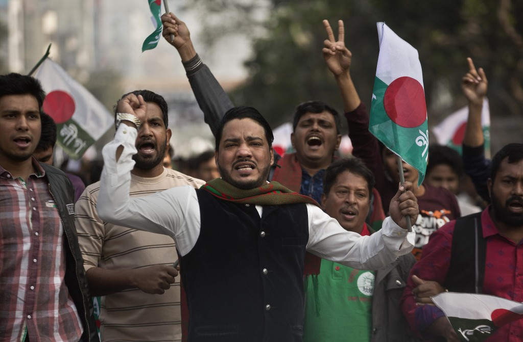 Supporters of Bangladesh Awami League shout slogans during an election rally ahead of the general elections in Dhaka, Bangladesh, Thursday, Dec. 27, 2...