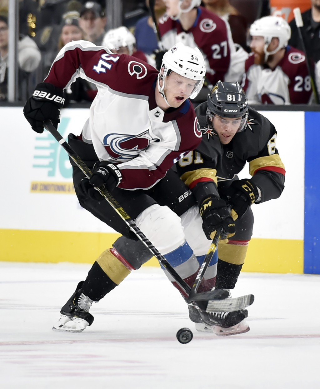 Colorado Avalanche center Carl Soderberg (34) and Vegas Golden Knights center Jonathan Marchessault vie for the puck during the third period of an NHL...