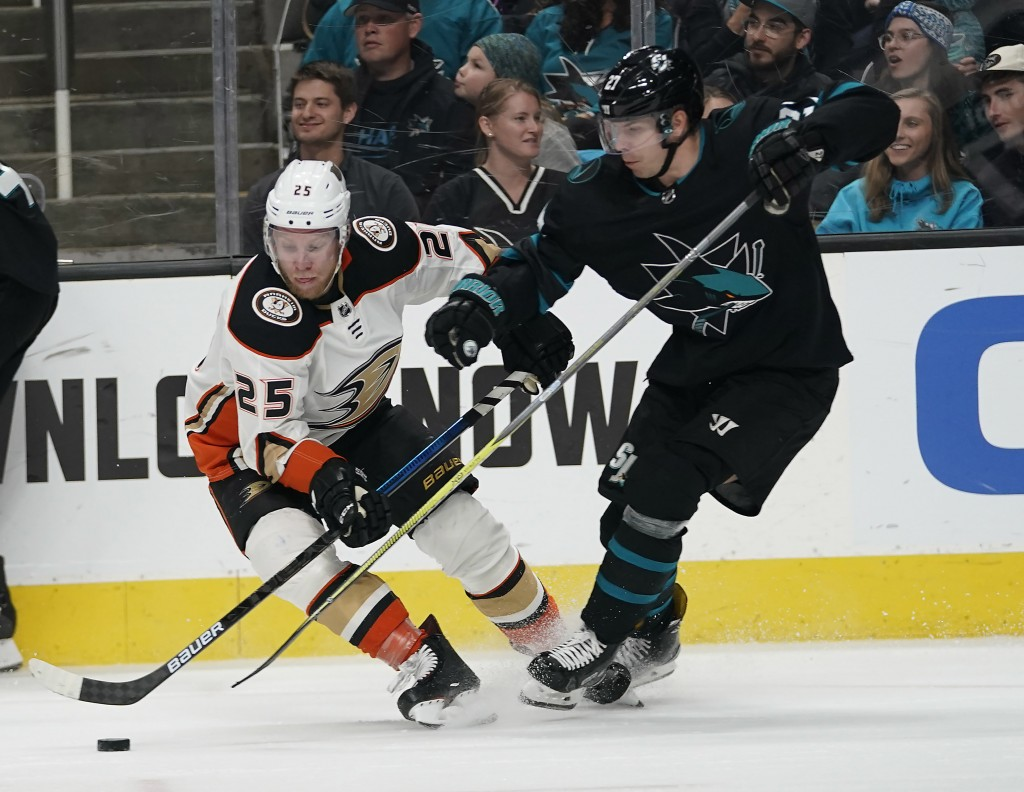 Anaheim Ducks right wing Ondrej Kase (25), of the Czech Republic, battles for the puck against San Jose Sharks right wing Joonas Donskoi (27) during t...