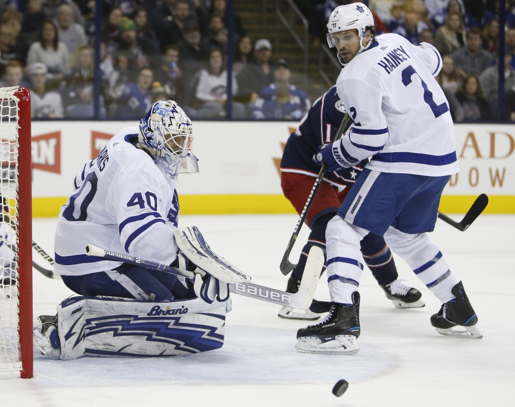 Toronto Maple Leafs' Garret Sparks, left, makes a savbe as teammate Ron Hainsey looks for the rebound during the second period of an NHL hockey game a...