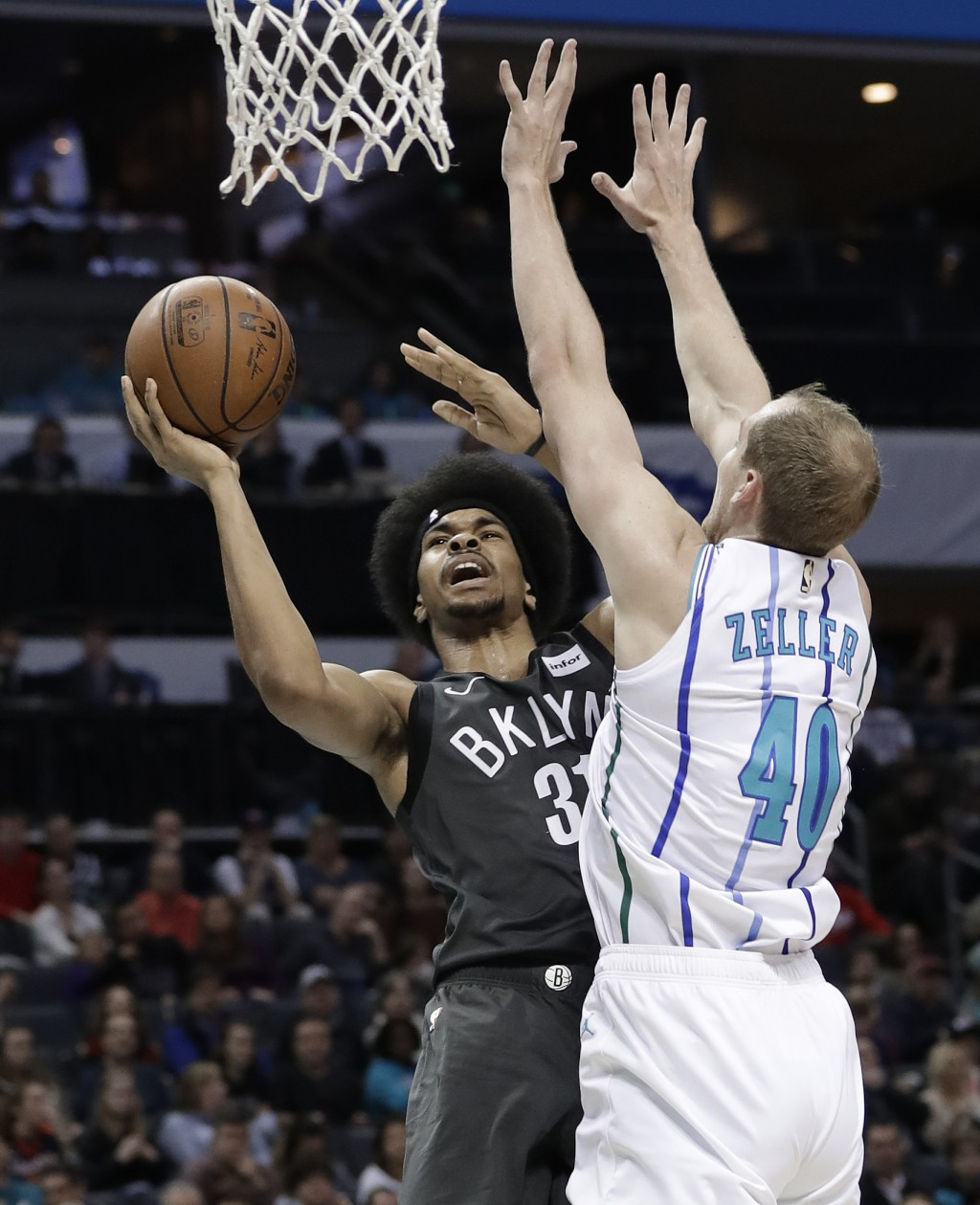Brooklyn Nets' Jarrett Allen (31) shoots against Charlotte Hornets' Cody Zeller (40) during the first half of an NBA basketball game in Charlotte, N.C...
