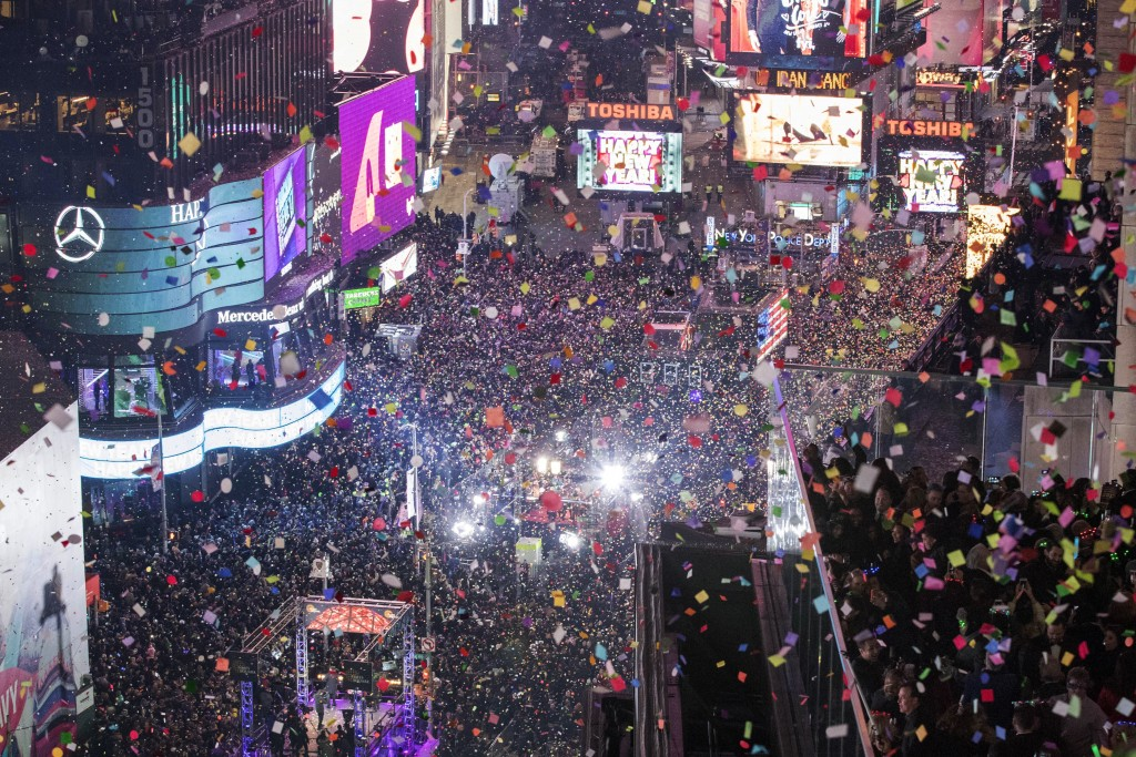 FILE - In this Jan. 1, 2017 file photo, revelers celebrate the new year as confetti flies over New York's Times Square. Year after year, people watchi...